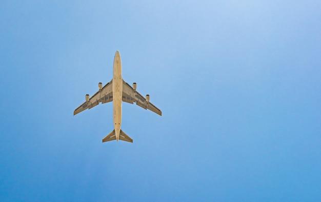 Passenger plane on blue sky