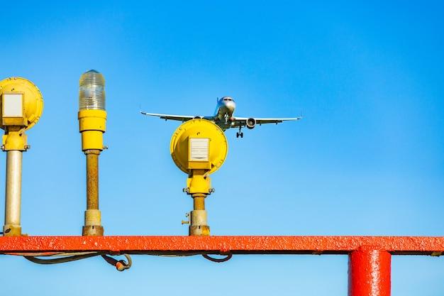 Passenger plane flying in the blue sky in sunlight rays