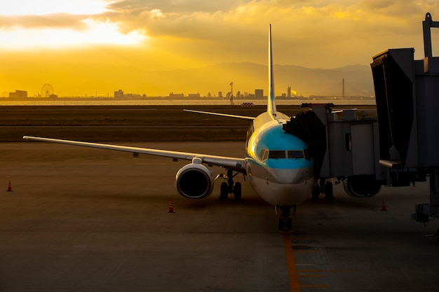 Passenger plane in international airport use for air transport and cargo logistic business Premium Photo