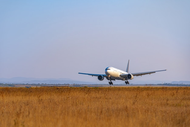 Passenger plane takes off from runway in airport