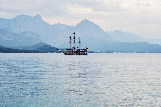 Passenger sea ship sailing at mountains in kemer, turkey