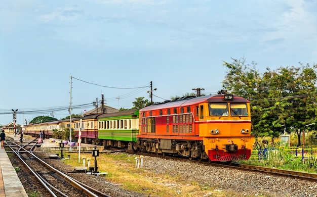 Passenger train for bangkok departs from ayutthaya station, thailand