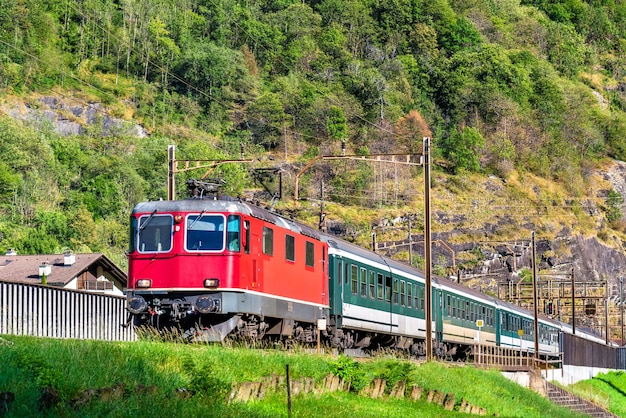 Passenger train climbing up the gotthard pass in switzerland