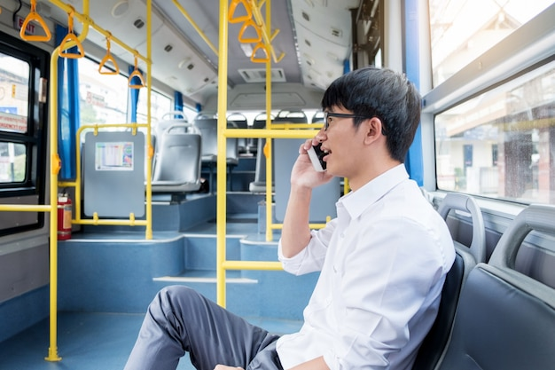 Passenger transport. people in the bus calling while riding home.