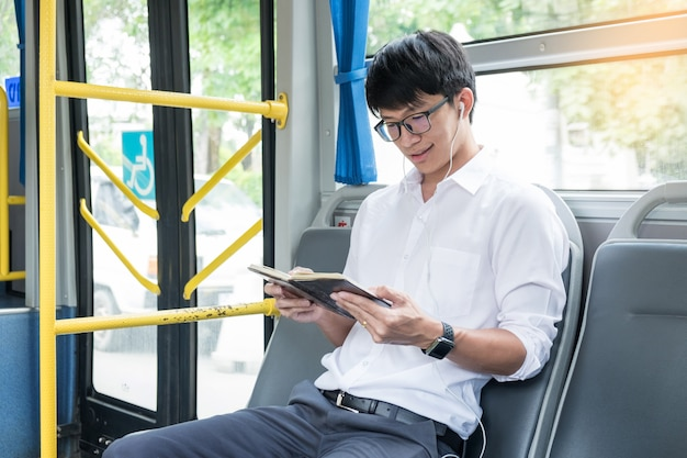 Passenger transport. people in the bus, listening music and reading book while riding home