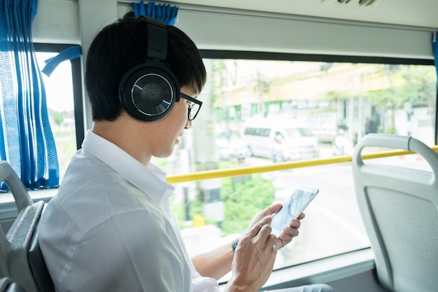 Passenger transport. people in the bus, listening to music while riding home.