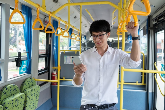 Passenger transport. people in the bus, listening music while riding home.