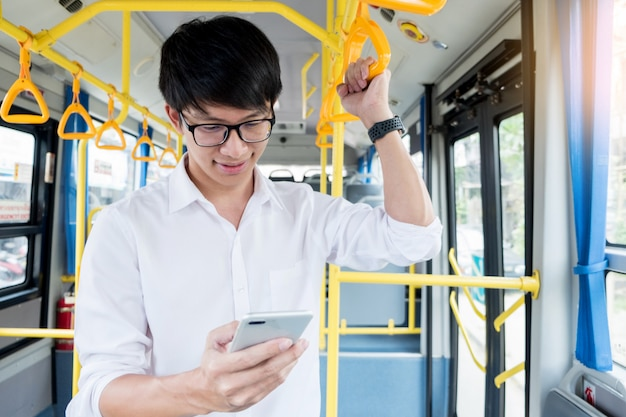 Passenger transport. people in the bus, typing a message while riding home.