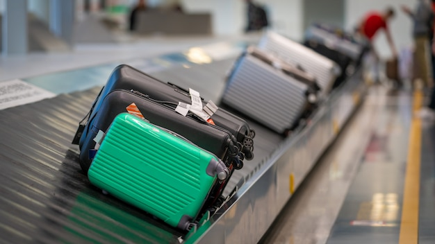 Passengers' bags on conveyor belt at the airport