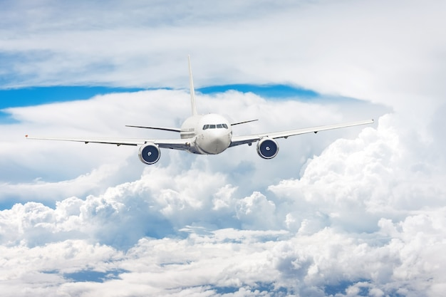 Passengers commercial airplane flying among the clouds