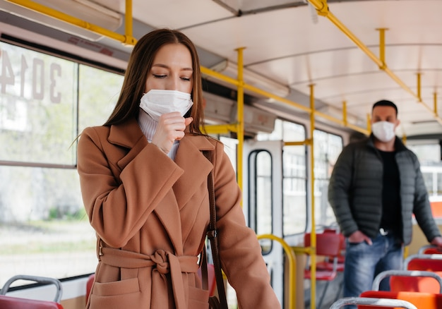 Passengers on public transport during the coronavirus pandemic keep their distance from each other. protection and prevention covid-19.