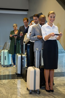 Passengers standing in a queue