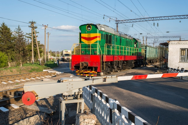 A passing train railroad crossing