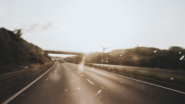 Passing windmills on a road trip