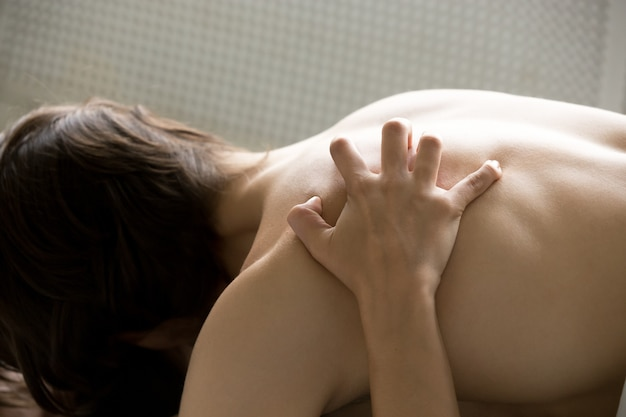 Passion concept, female hand scratching male back having sex, closeup