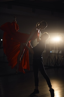 Passion dance couple, woman jumping