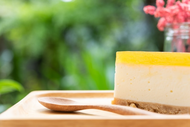 Passion fruit cheesecake serve on wood tay and wooden table