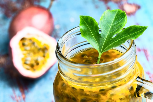 Passion fruit in a glass jar with whole and half fruit