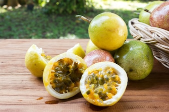 Passion fruit on wooden background.