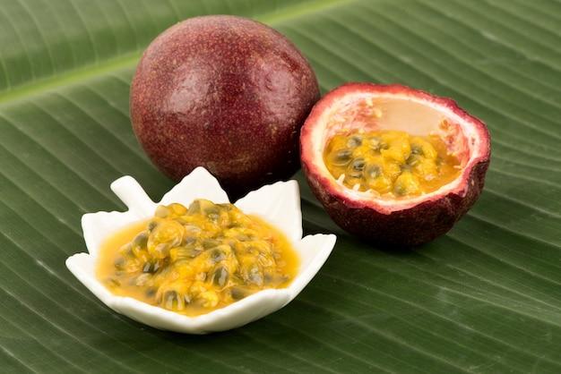 Passion fruit or passiflora edulis fruits on banana green leaf