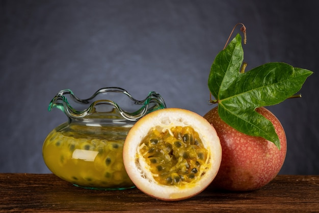 Passion fruit or passiflora edulis fruits and extracted on an old wood background.