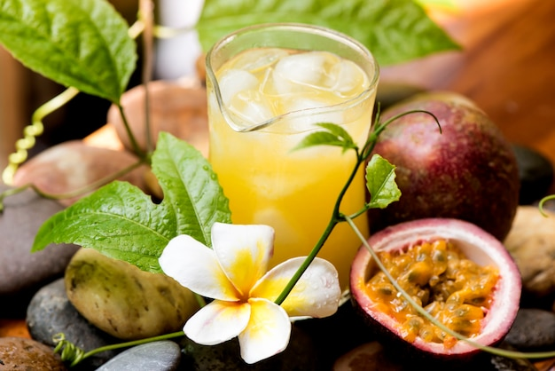 Passion fruit or passiflora edulis fruits and juice on nature background