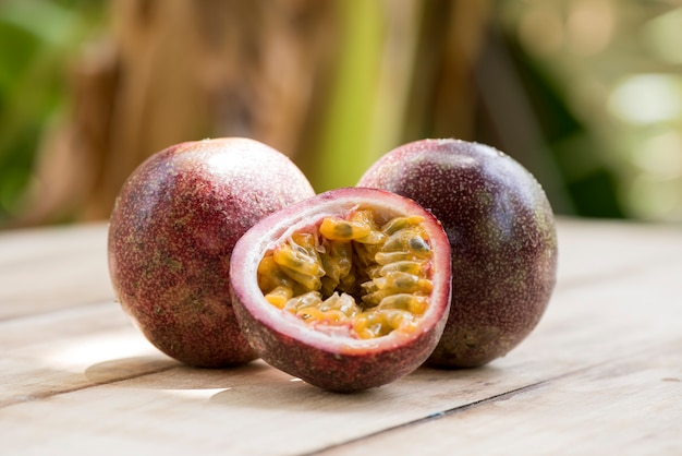 Passion fruit or passiflora edulis fruits on nature background