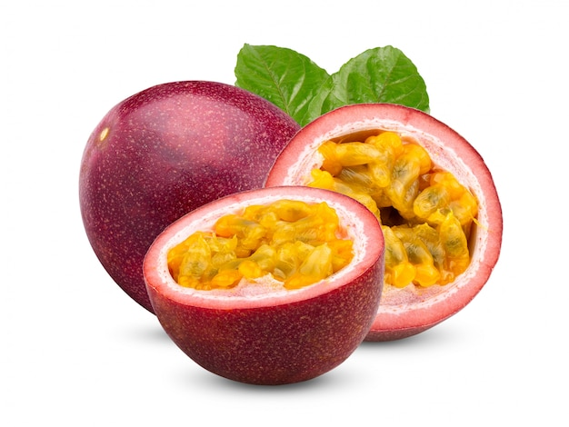 Passion fruit with leaves on white wall.