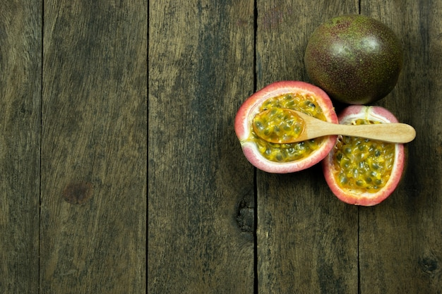 Passion fruit on wood table copyspace