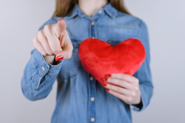 Passion relief gesture new people person jeans help hope life casual care day student date chest attack concept. cropped close up photo of lady selecting you heart near body isolated gray background