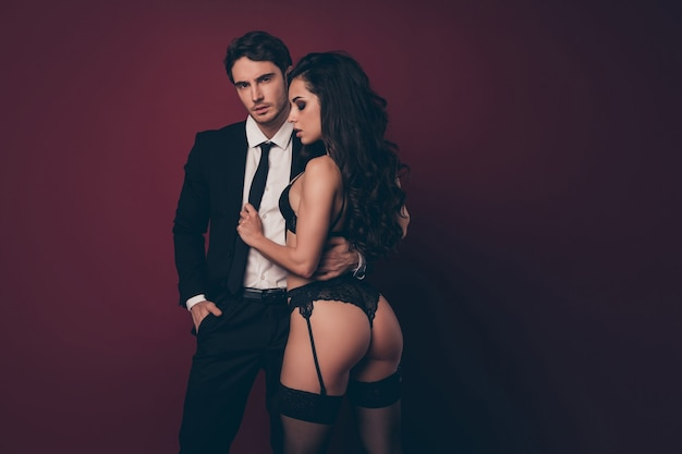 Passionate couple, girl touching confident guy