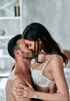 The passionate couple having sex in the bedroom