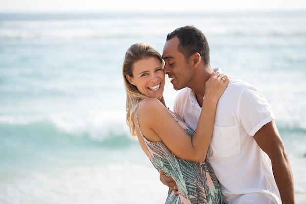 Passionate husband reaching to kiss his wife