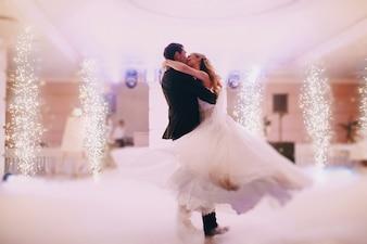 Passionate newlyweds dancing