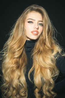 Passionate sexy attractive beautiful blonde woman with healthy long hair perfect makeup open mouth