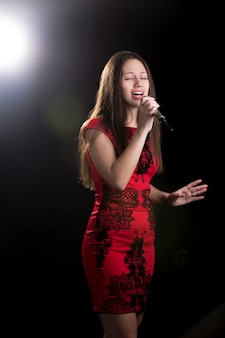 Passionate singer in red dress
