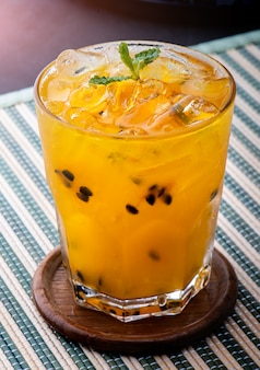 Passionfruit juice with ice .
