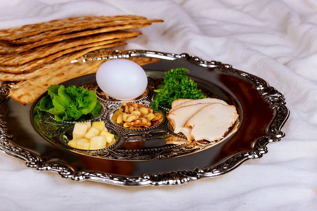 Passover background with wine bottle, matzoh, egg and seder plate