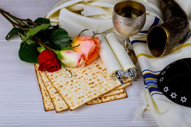Passover holiday concept with wine and matzoh over background
