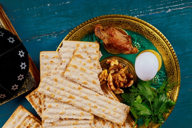 Passover matzoh jewish holiday bread over wooden table.