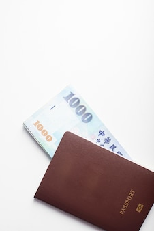 Passport and 1000 new taiwan dollar bill on white background