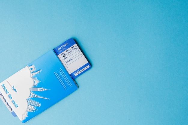 Passport and air ticket on a pink background. travel concept, copy space