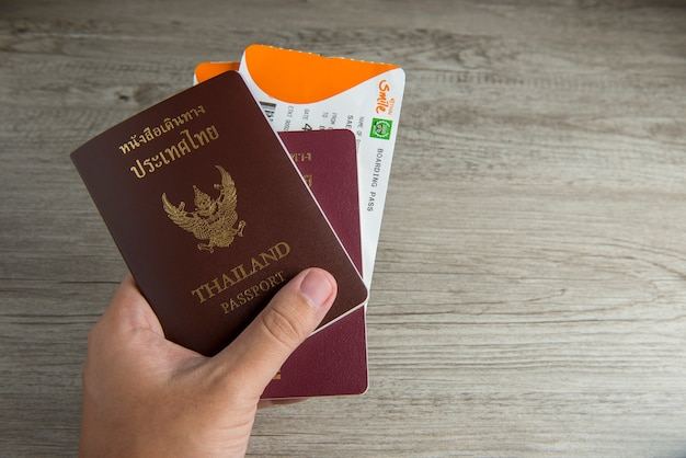 Passport and boarding pass on hand