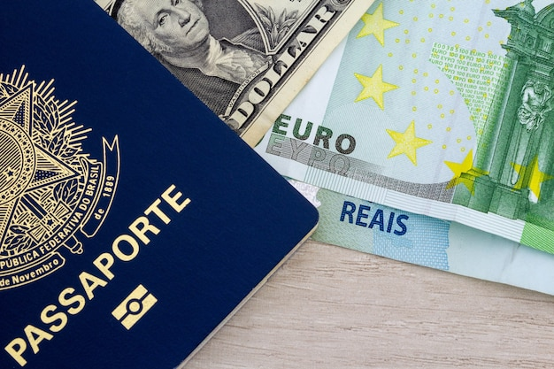 Passport and brazilian money, euro and dollar in paper.