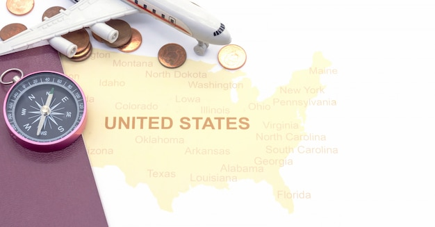 Passport compass and coins on a american map. business travel concept