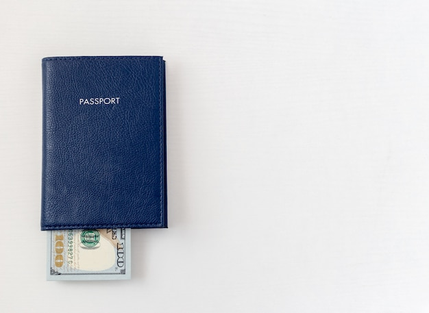 Passport and dollar bills on isolated white