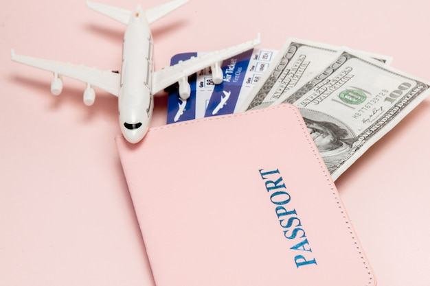 Passport, dollars, plane and air ticket. travel concept, copy space