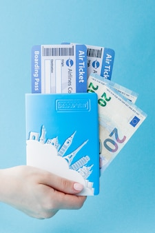 Passport, euro and air ticket in woman hand