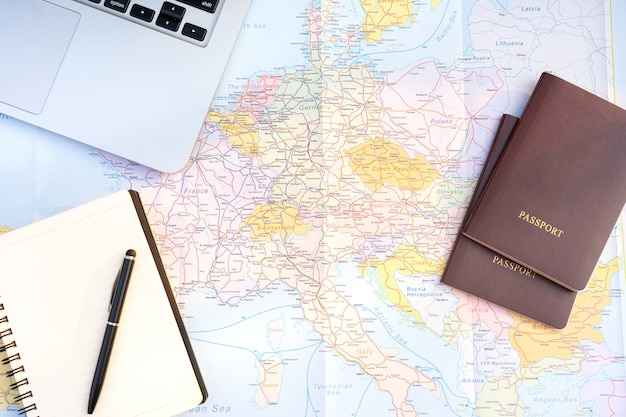Passport on europe map background. travel planning.