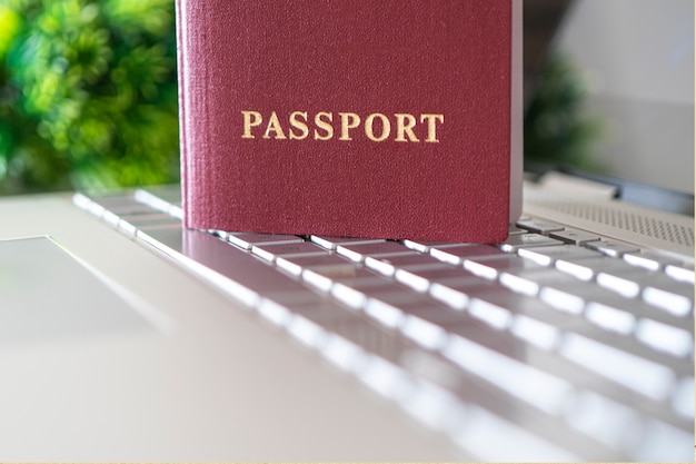 Passport on the keyboard. concept of online identification when registering on a website on the internet. internet by passport. purchase of plane tickets. hotel booking. online check-in for flight